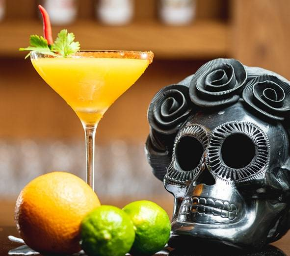 Meshico Restaurant Group Skull and Cocktail