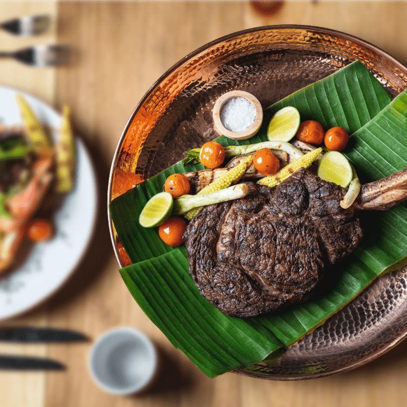 Meshico Restaurant Group steak and vegetables on a leaf
